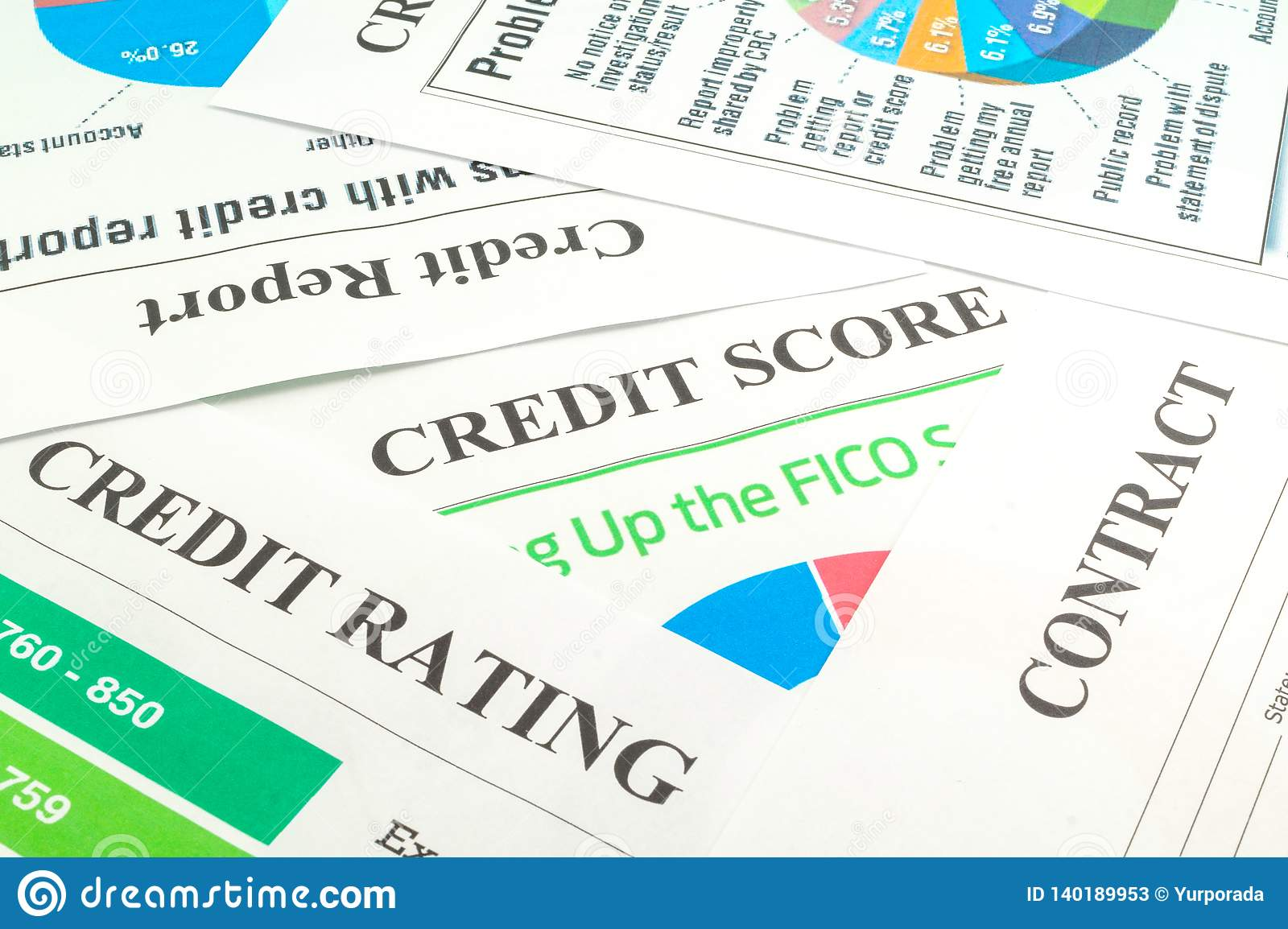 Credit score, report, rating and contract on the table.