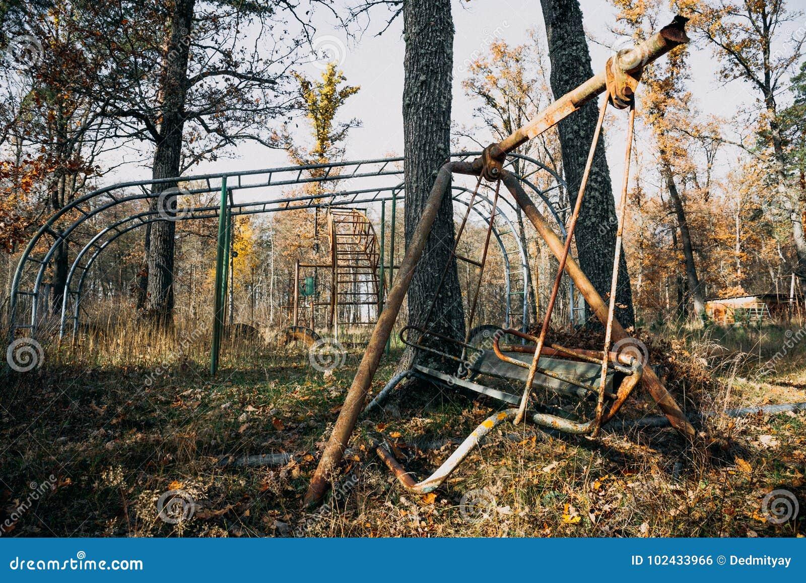Creepy Abandoned Children Playground Among Autumn Trees Rusty Swing Stock Photo Image Of Exercise Game 102433966
