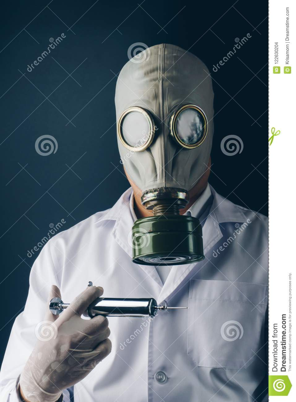 A Scary Doctor In Gas Mask With A Big Stainless Steel