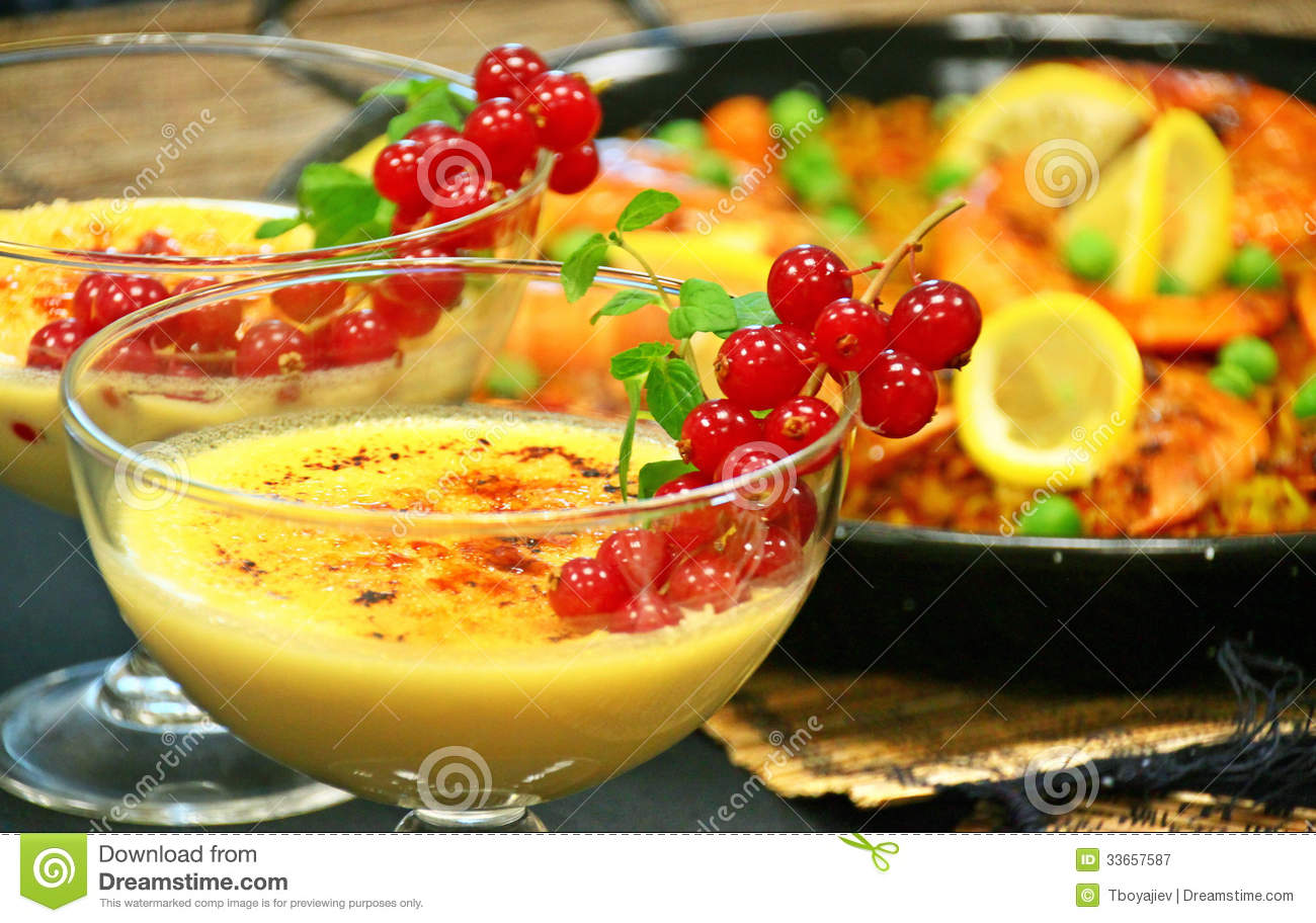 Crema catalana and paella spanish lunch royalty free stock for Cuisine in spanish