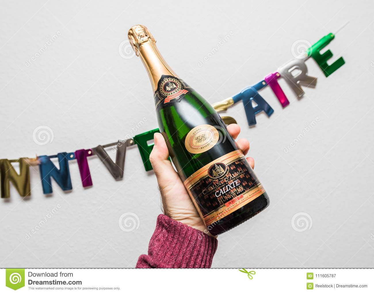 Cremant D Alsace Calixte Hunawihr In Male Hand Against Joyeux An