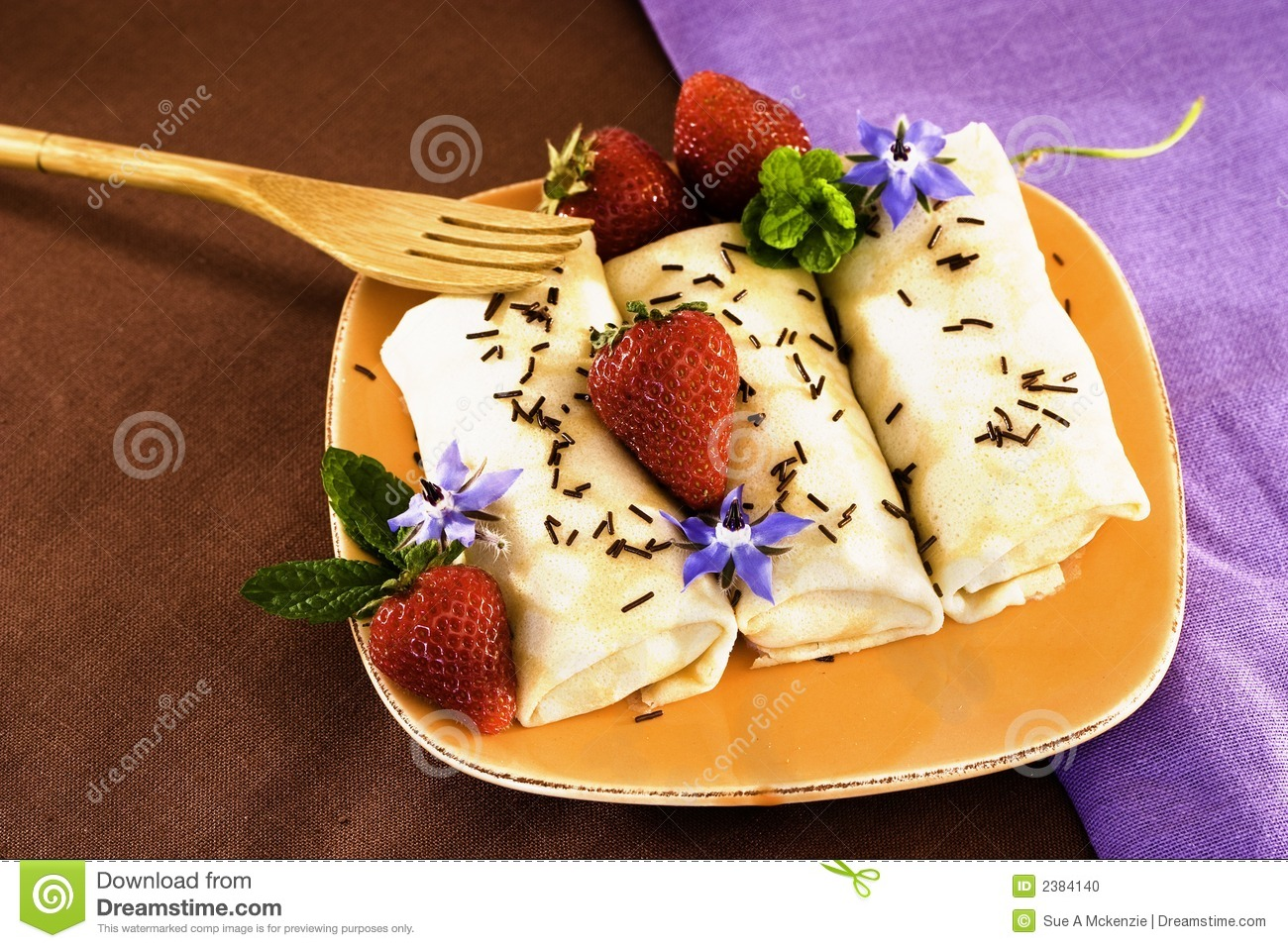 Crepes On Golden Plate With Mint, Chocolate Sprinkles, Strawberries ...
