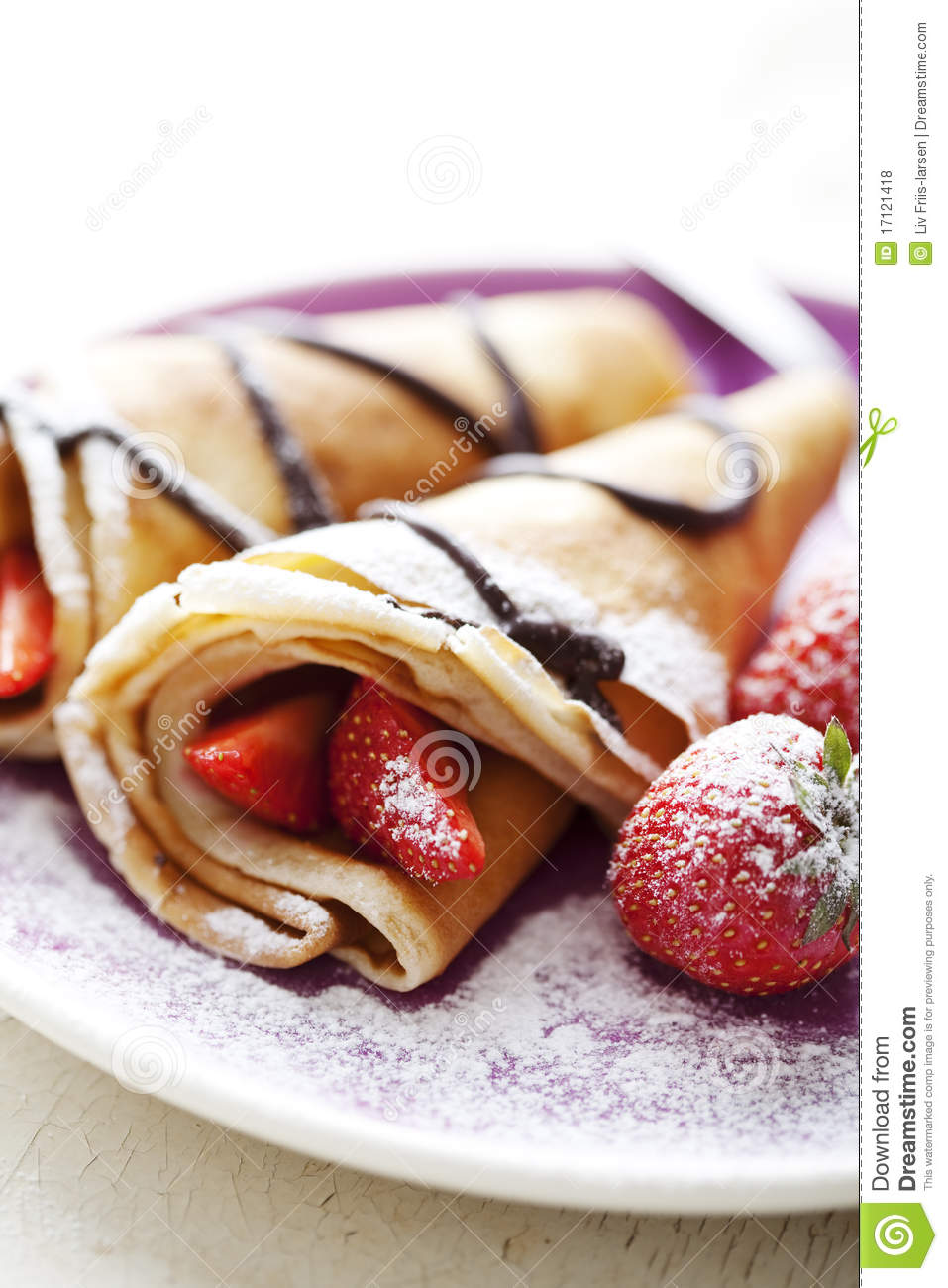 Sweet thin french style crepes, served with strawberries,chocolate ...