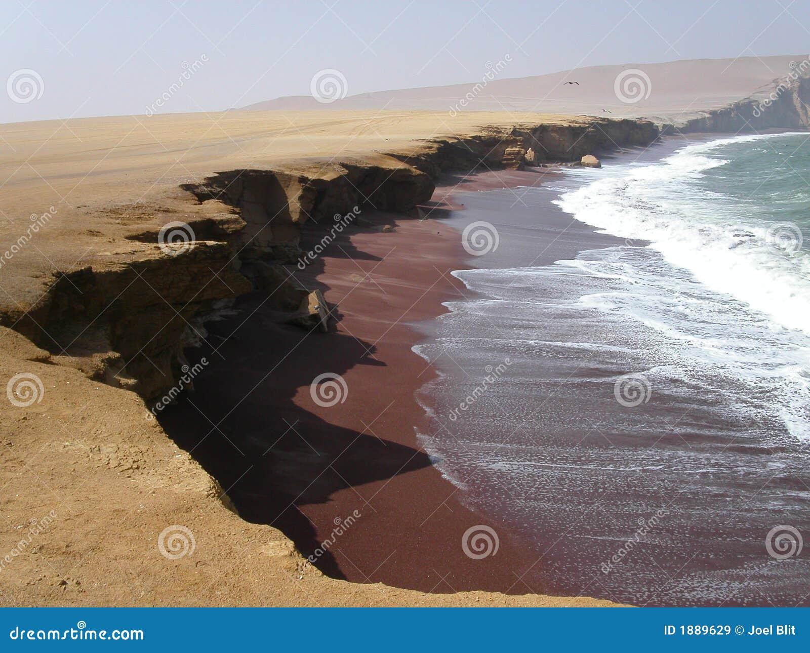 Crescent beach with dark brown sand