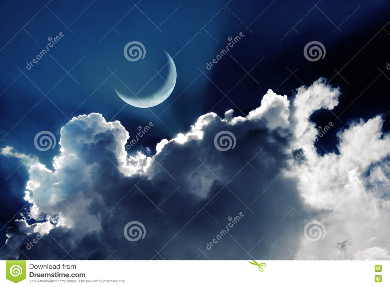 Crescent moon in a beautiful night sky with glowing clouds