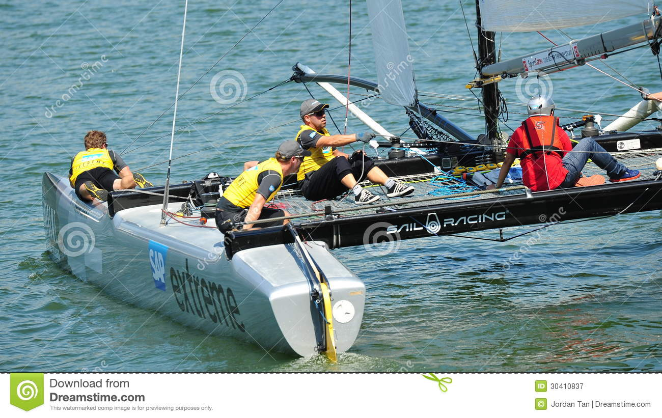 Crew Of SAP Extreme Sailing Team Steering Boat At Extreme