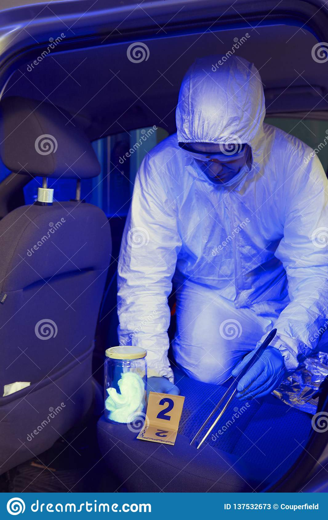 Police team working in ultraviolet light on collecting of traces and evidences