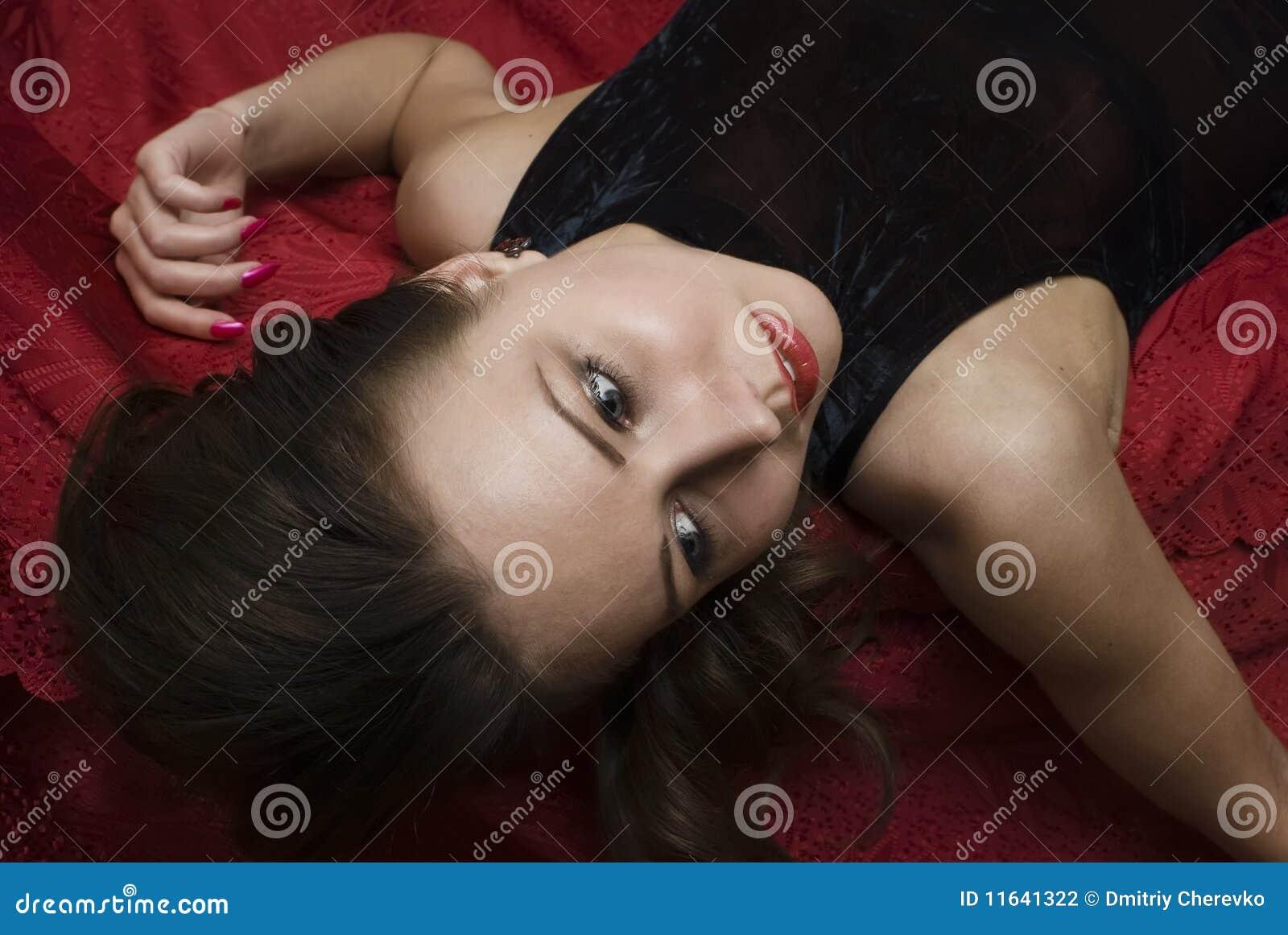 Stock Photography: Crime scene: dead woman lying on the sofa