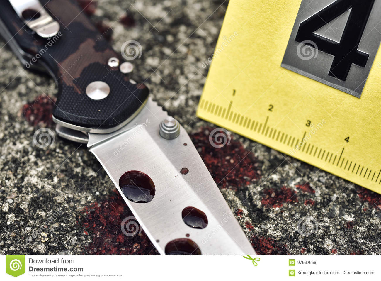 Crime scene investigation, Bloody knife and victim`s shoes with criminal markers on ground, Homicide evidence.
