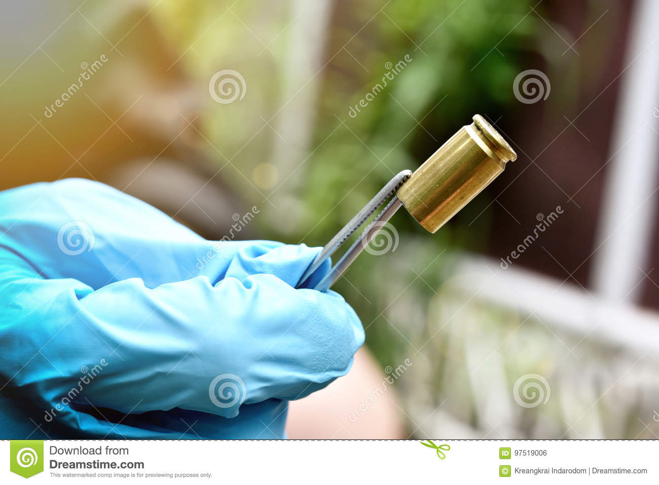 Crime scene investigation, Detective collecting bullet shell with blood stain