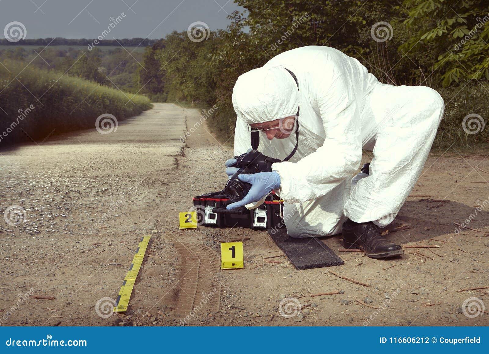 Technician Criminologist Photographing Tire Print Left In
