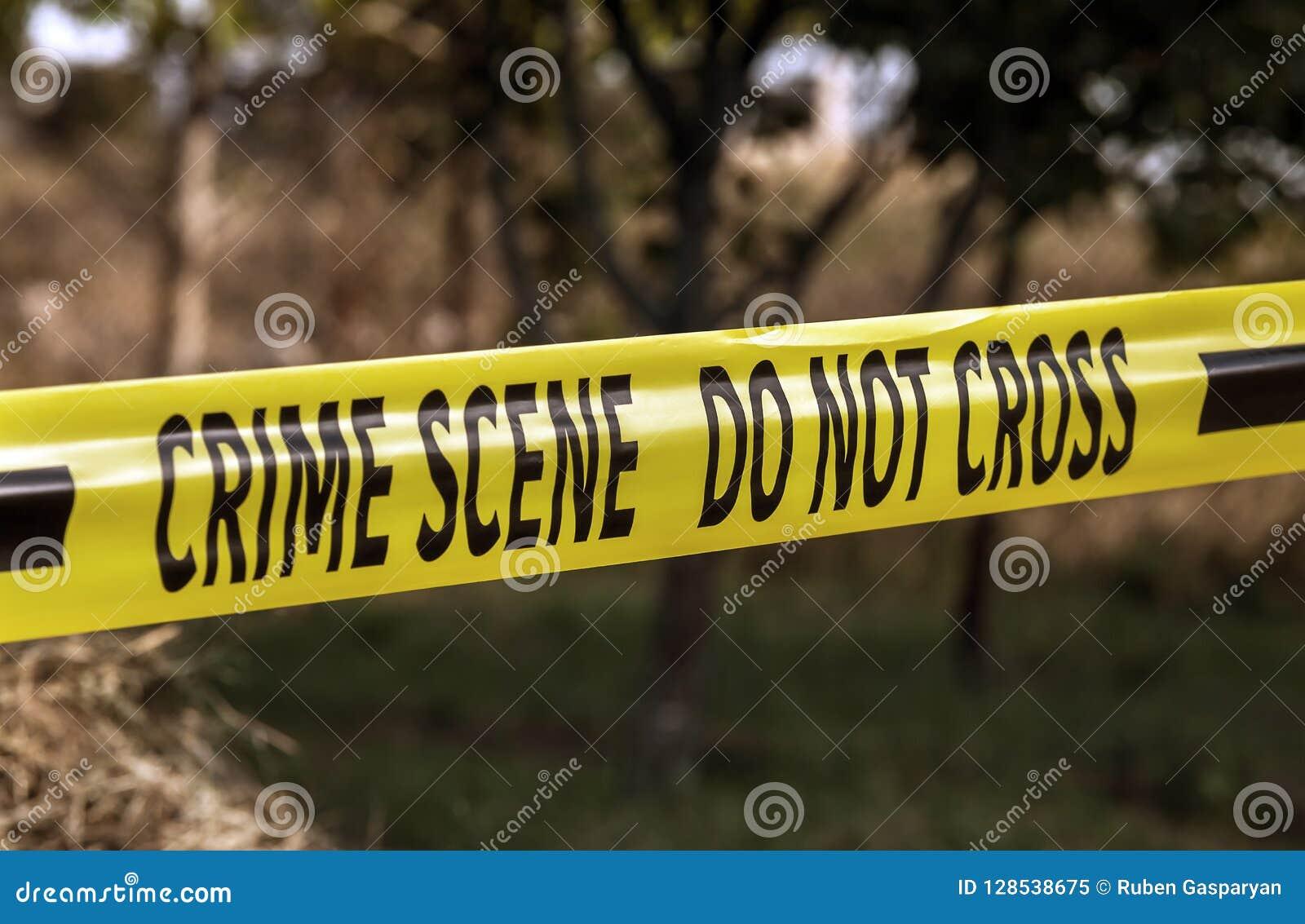 Crime scene yellow police tape closeup