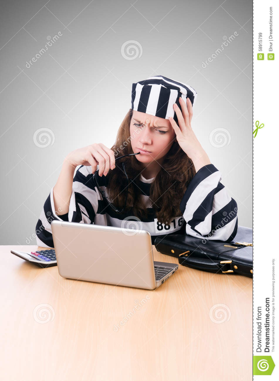 Criminal hacker with laptop against the gradient