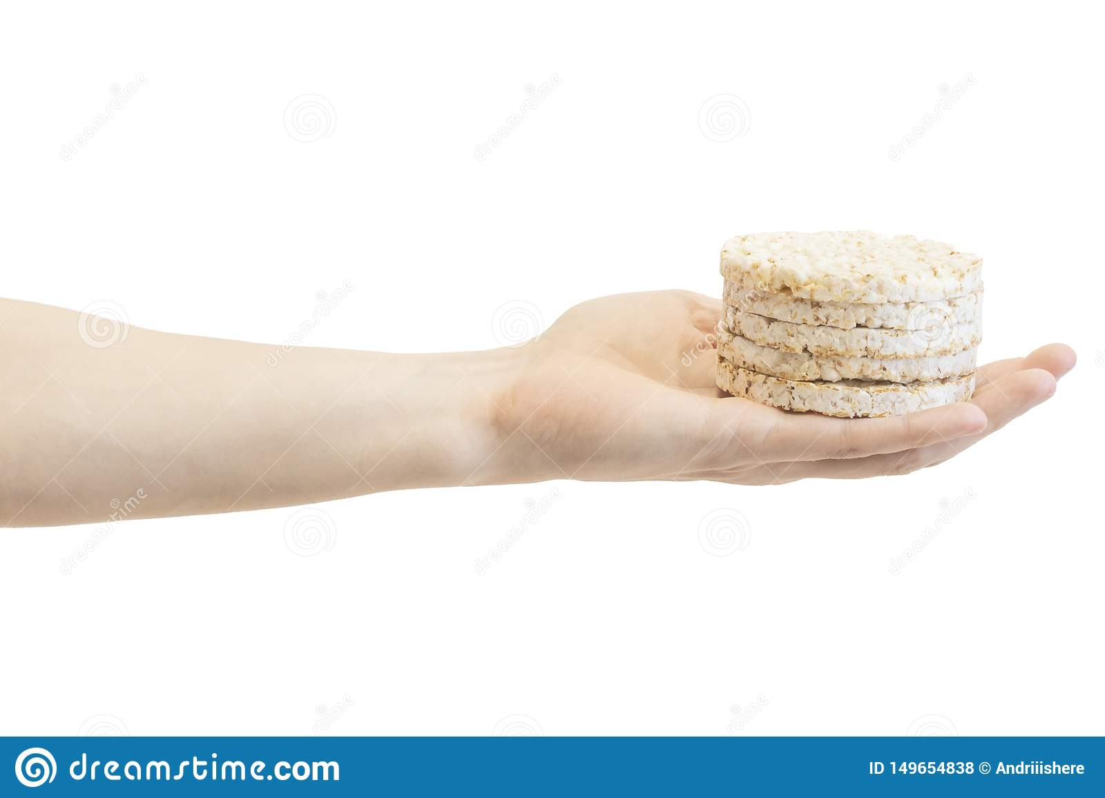 Round rice crispbreads in male`s hand isolated on white background