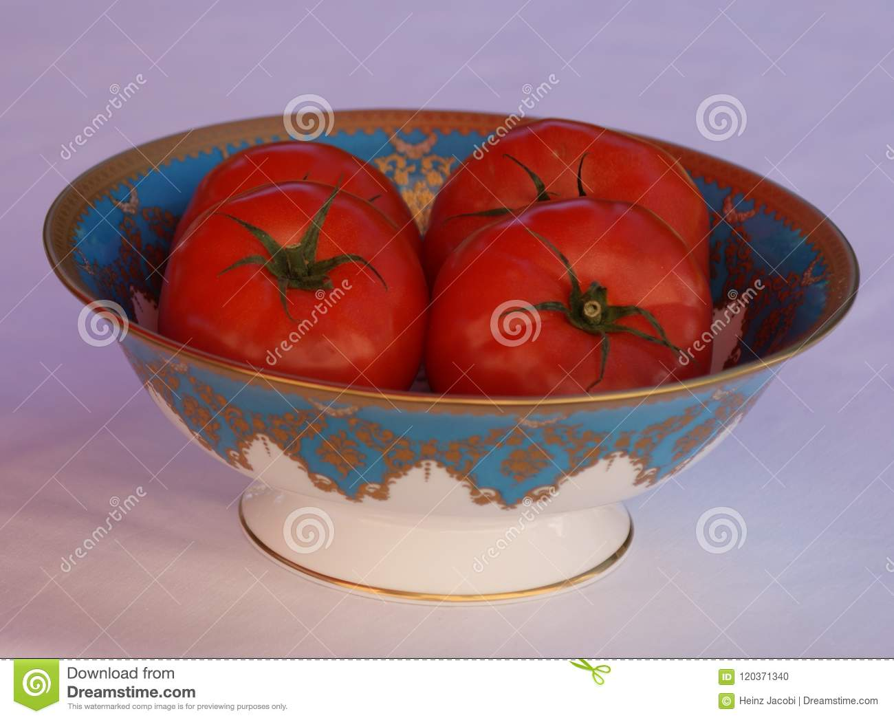 A bon china porcelain bowl filled with beef tomatoes