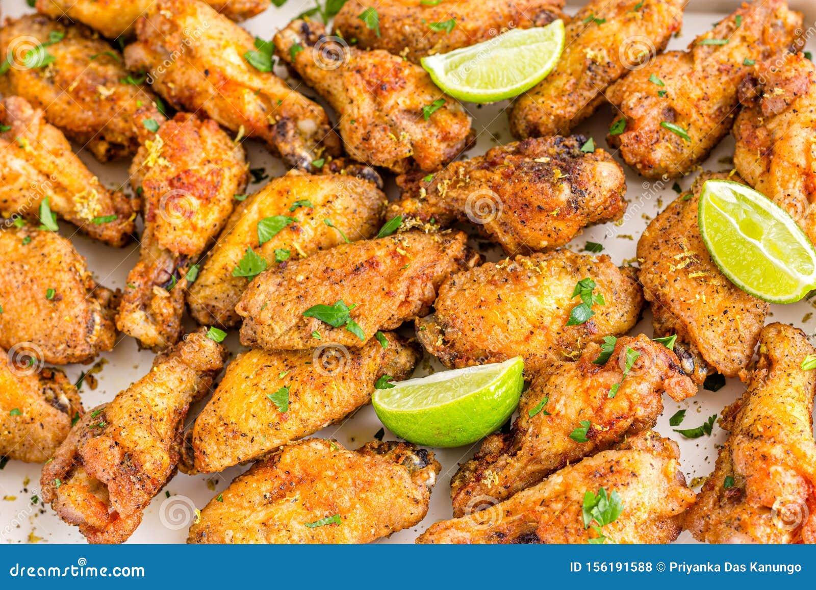 Crispy Fried Lemon Pepper Chicken Wings with Lemon Wedges