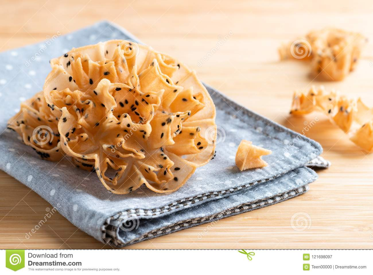 Crispy Lotus Blossom Cookie On Wooden Background Stock Image