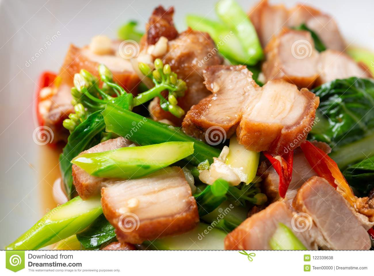 Crispy Pork Belly Stir Fry With Chinese Kale Stock Photo