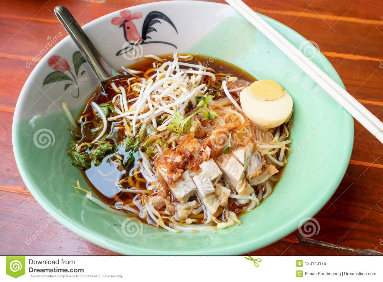 Crispy Pork Noodles With Egg In Bowl Stock Photo - Image of