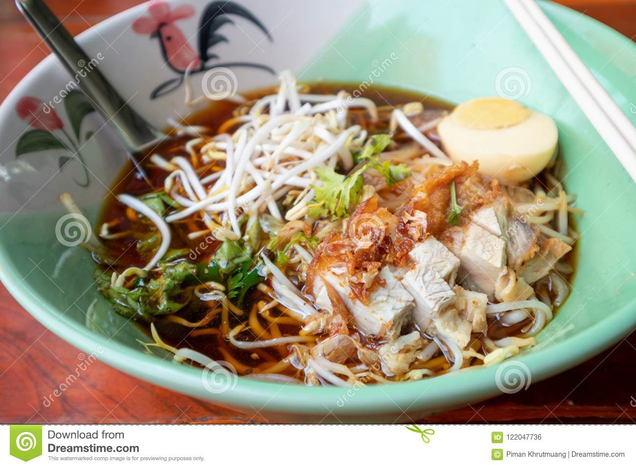 Crispy Pork Noodles With Egg In Bowl Stock Photo - Image of meal