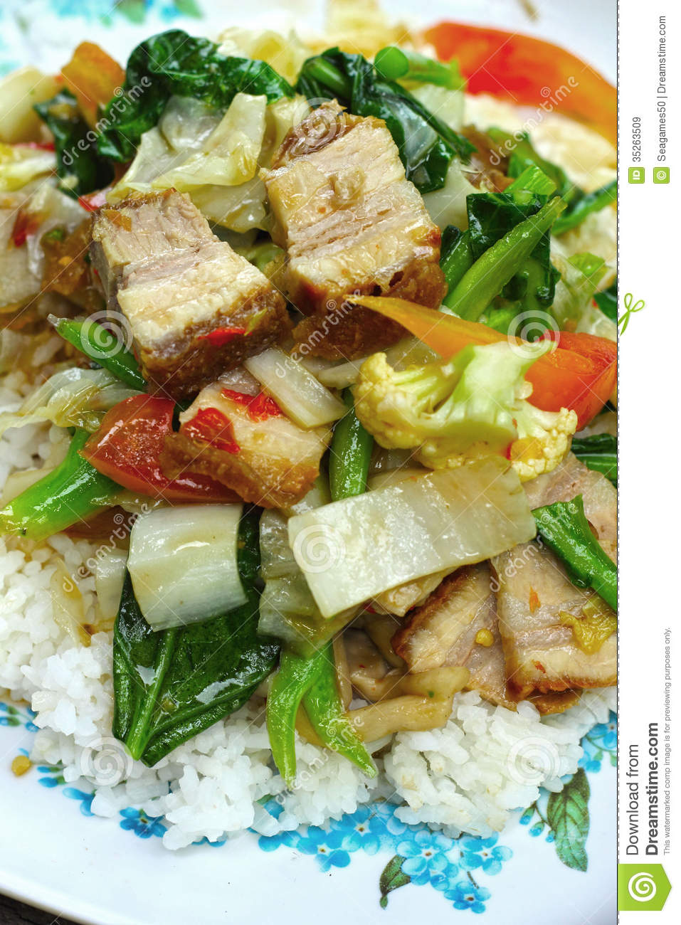 Crispy Roasted Pork Stir Fry With Vegetables And Rice  Stock Image