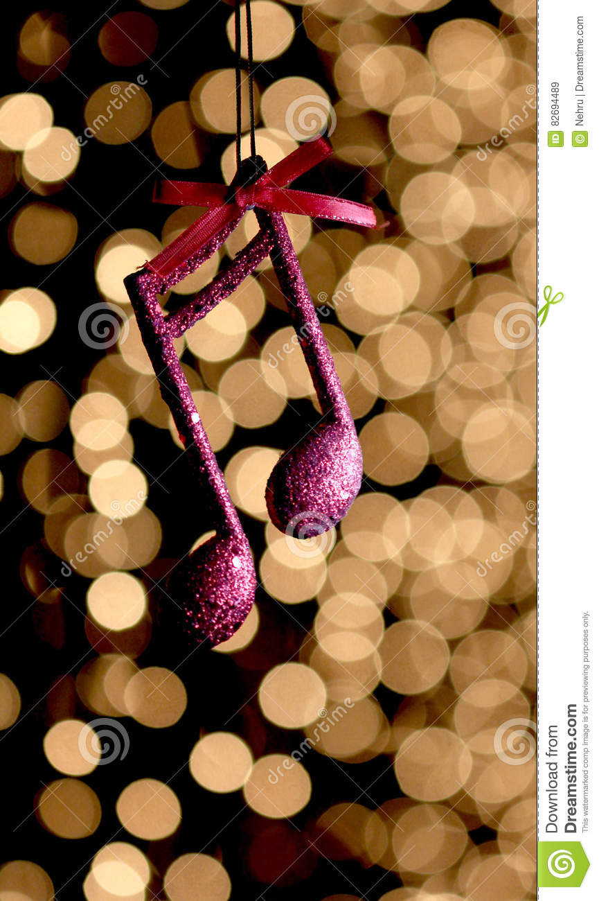 Cristmas music note decoration in front of a bokeh lights