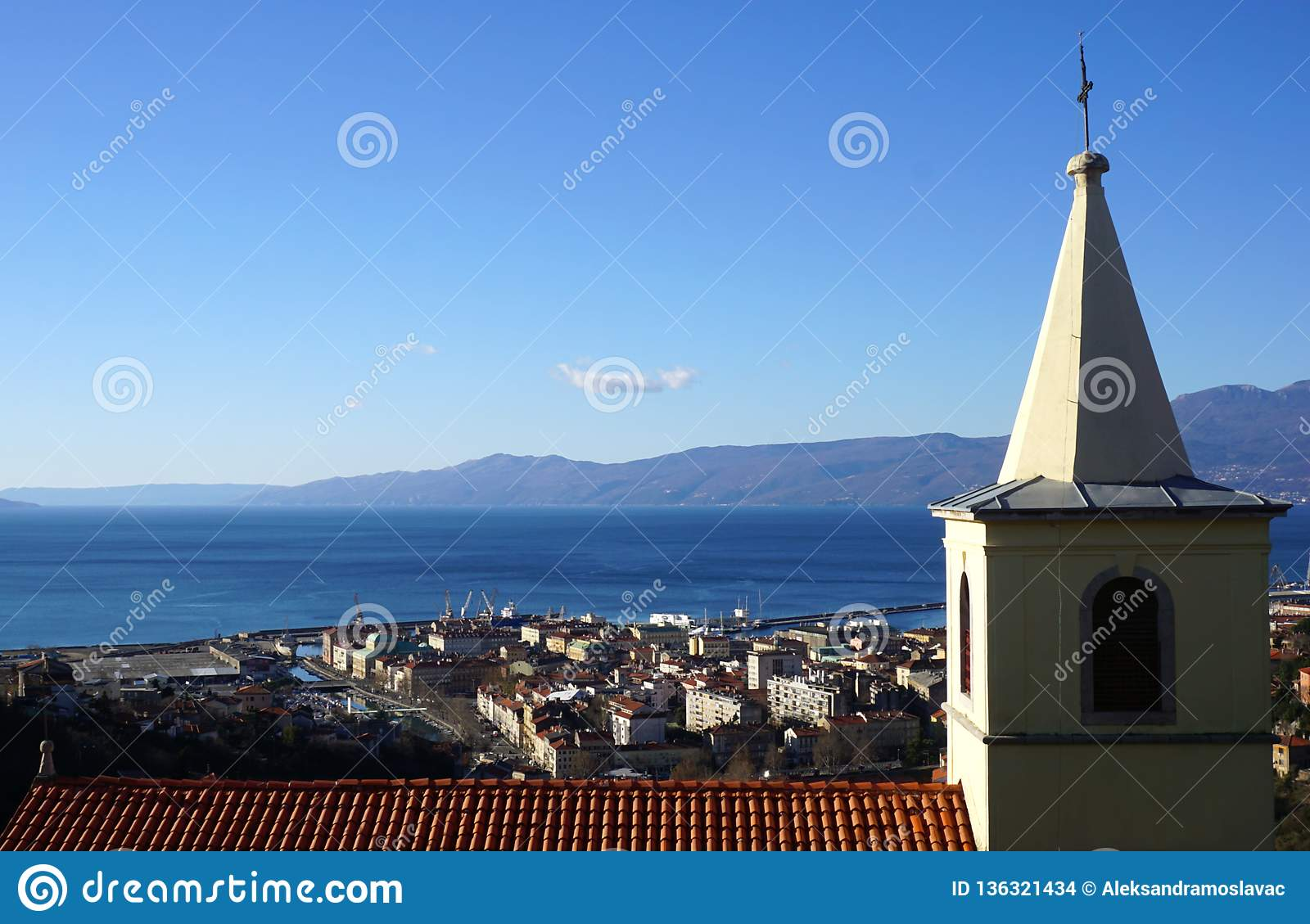 Croatian town Rijeka. Oldest Trsat church – Saint George the Martyr, side view, with aerial view to town and Kvarner region