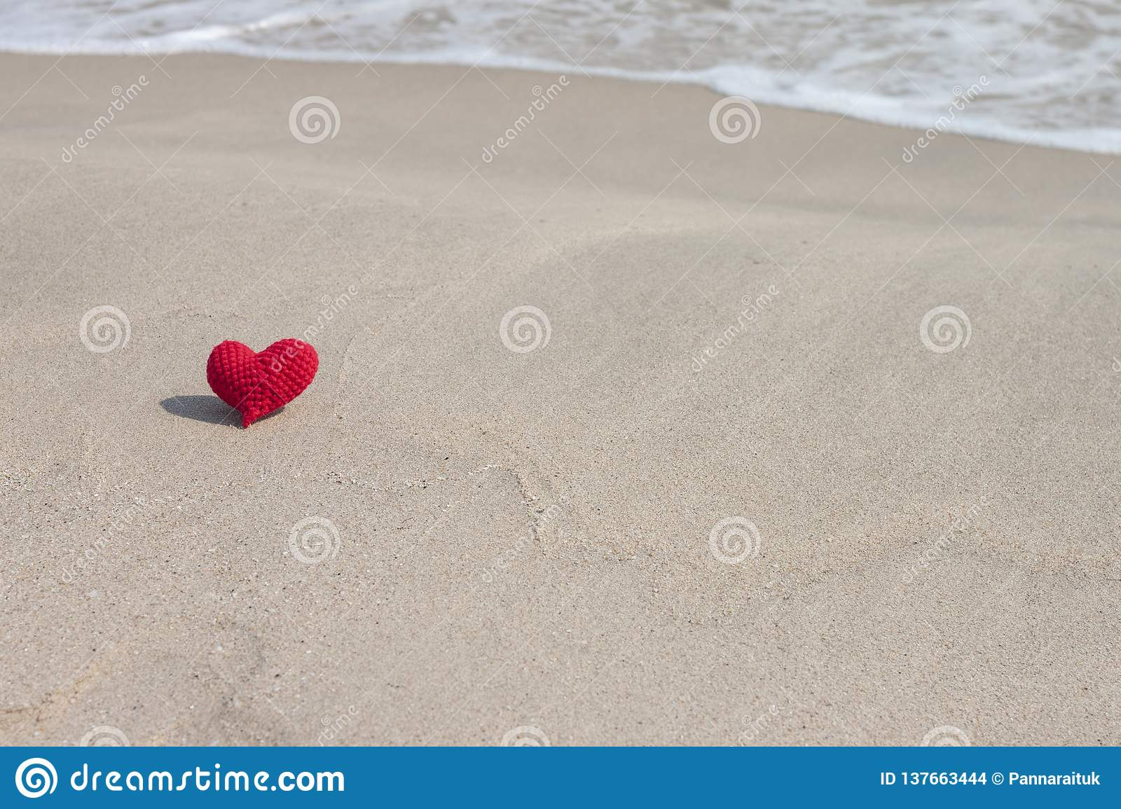 Crochet Red Heart With Yarn On Sand Beach For Valentine`s