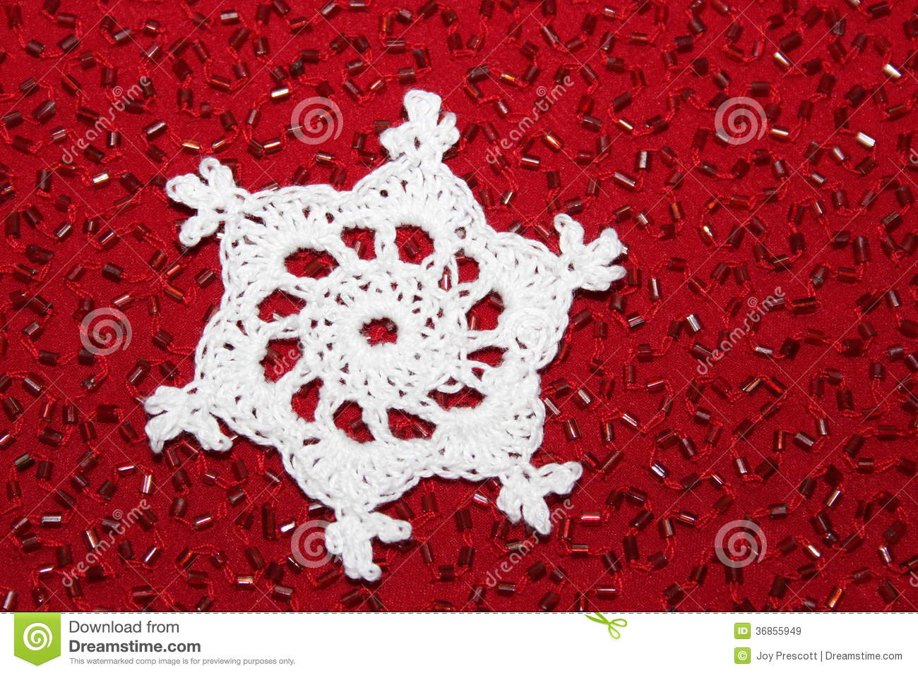 Crochet snowflake with red bead background royalty free stock images