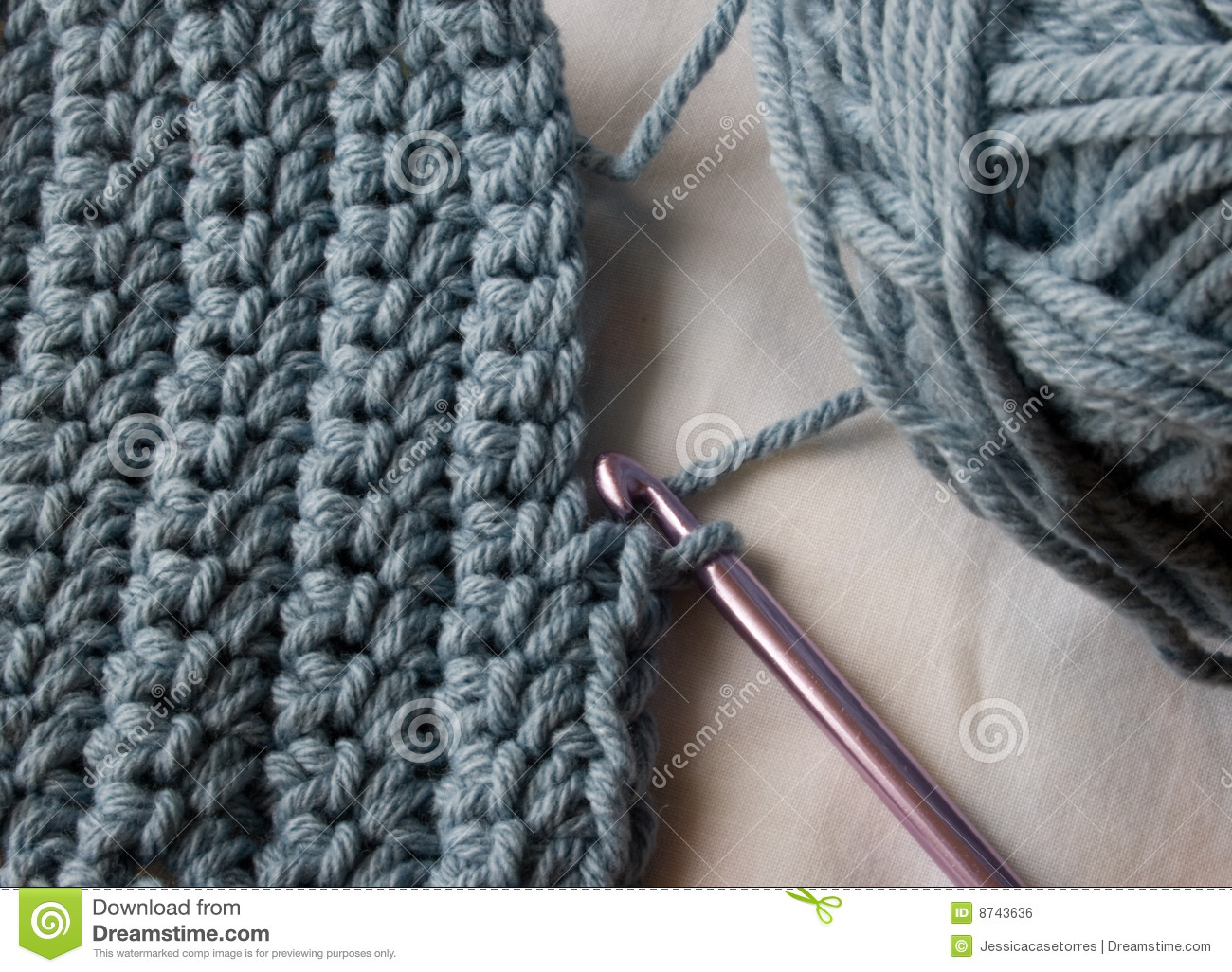 Crochet Stitches Us : pink crochet hook is still in a crochet stitch made with blue yarn.