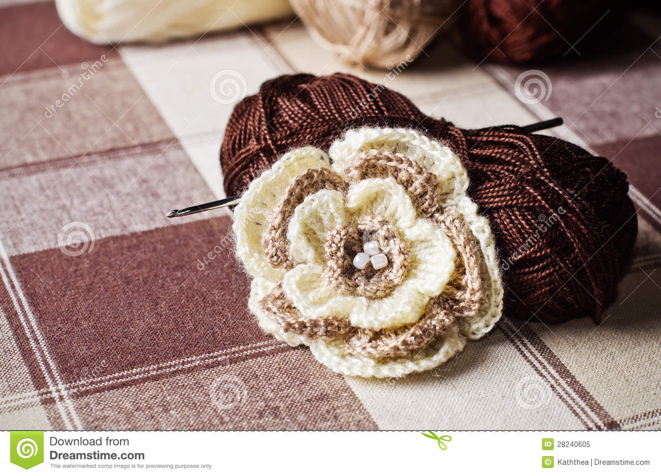 Crochet Work : Crochet work: skeins of yarn, crochet hook and crocheted flower.