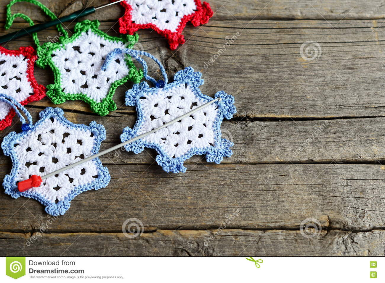 White crocheted snowflakes on red royalty free stock for Crochet crafts for kids