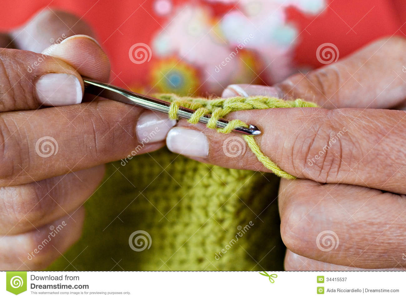 Crocheting With Your Hands : Woman?s hands crochetingclose up.