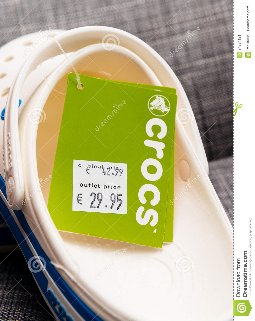 3f83312d460b6e ... 2016  Pair of new Crocs foam clogs on with regular price tag and outlet  price tag reduction. Crocs is a worldwide company selling comfortable shoes