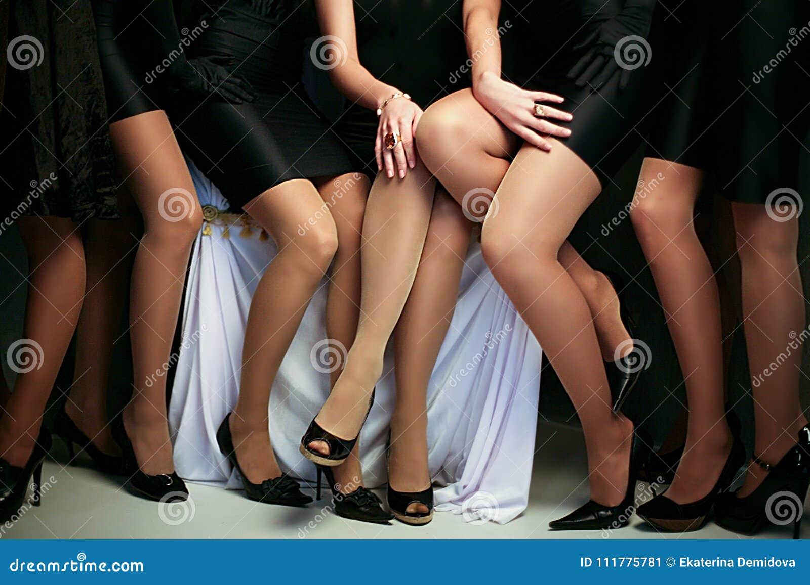 Crop female slender legs in group