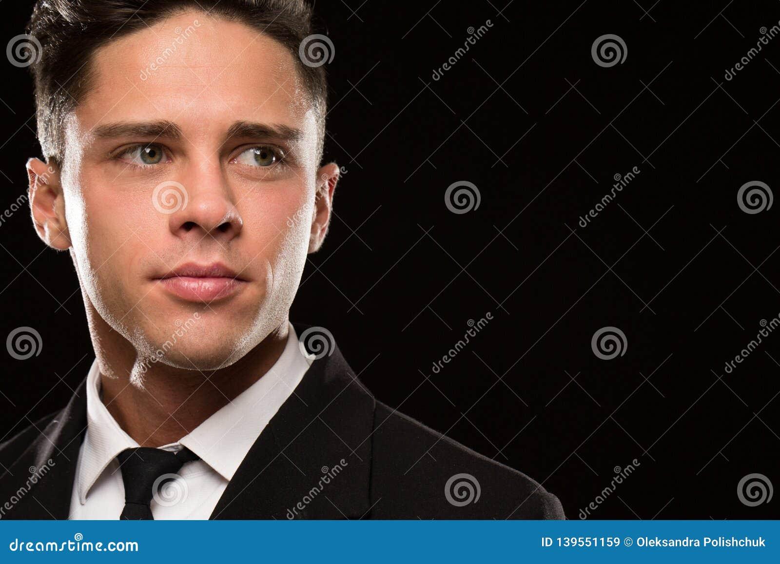 Fierce bodyguard in a black suit