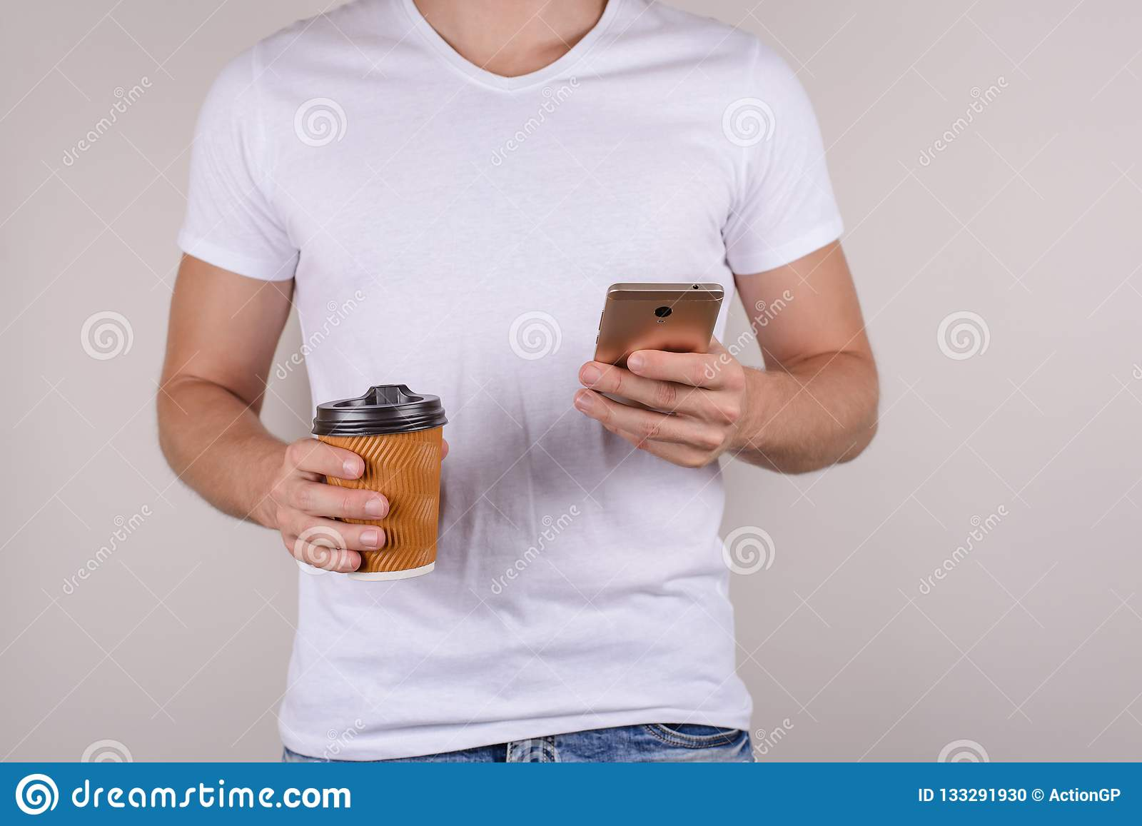 Cropped close up photo of handsome virile masculine tanned skinned attractive people person student drinking hot beverage using c