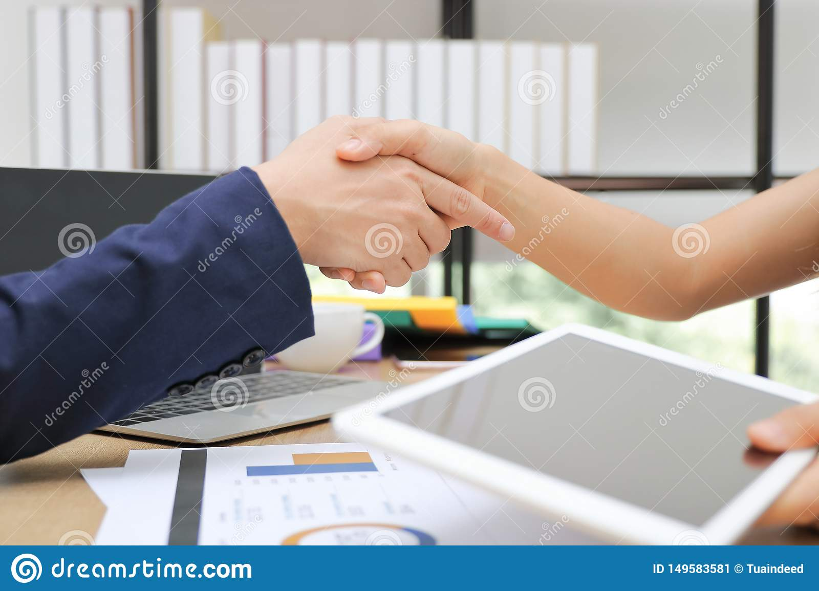 Cropped image of business people shaking hands with partners after finishing a meeting. Handshake greeting deal concept