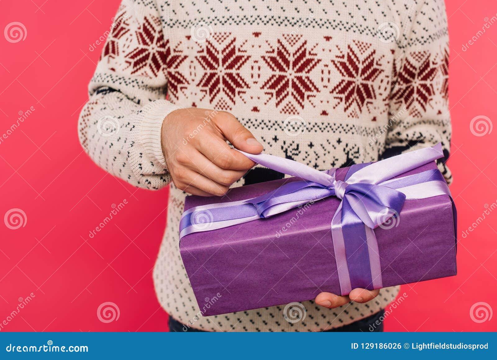 cropped image of man opening gift box