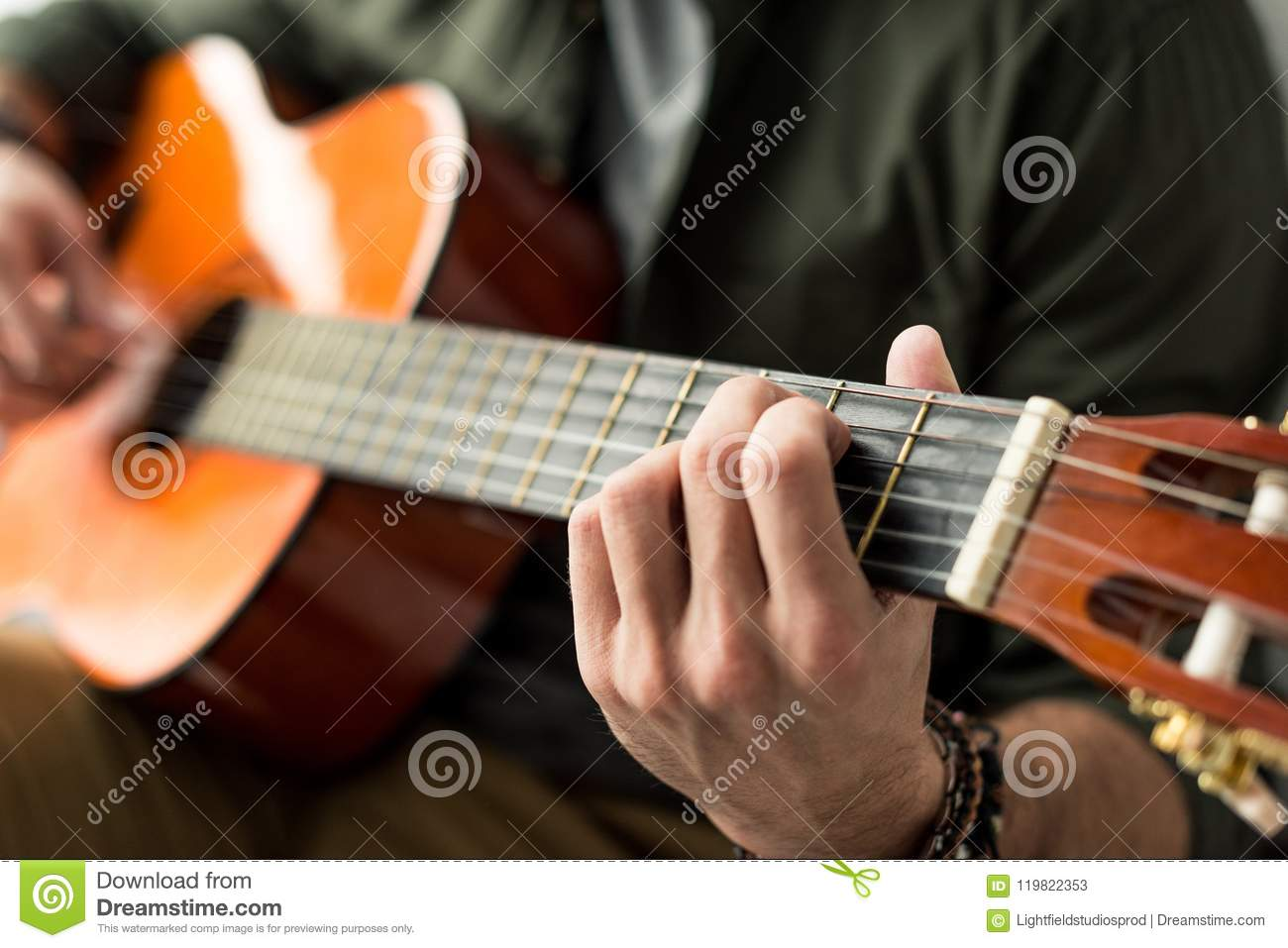 Cropped Image Of Man Playing Chord On Acoustic Guitar Stock Image