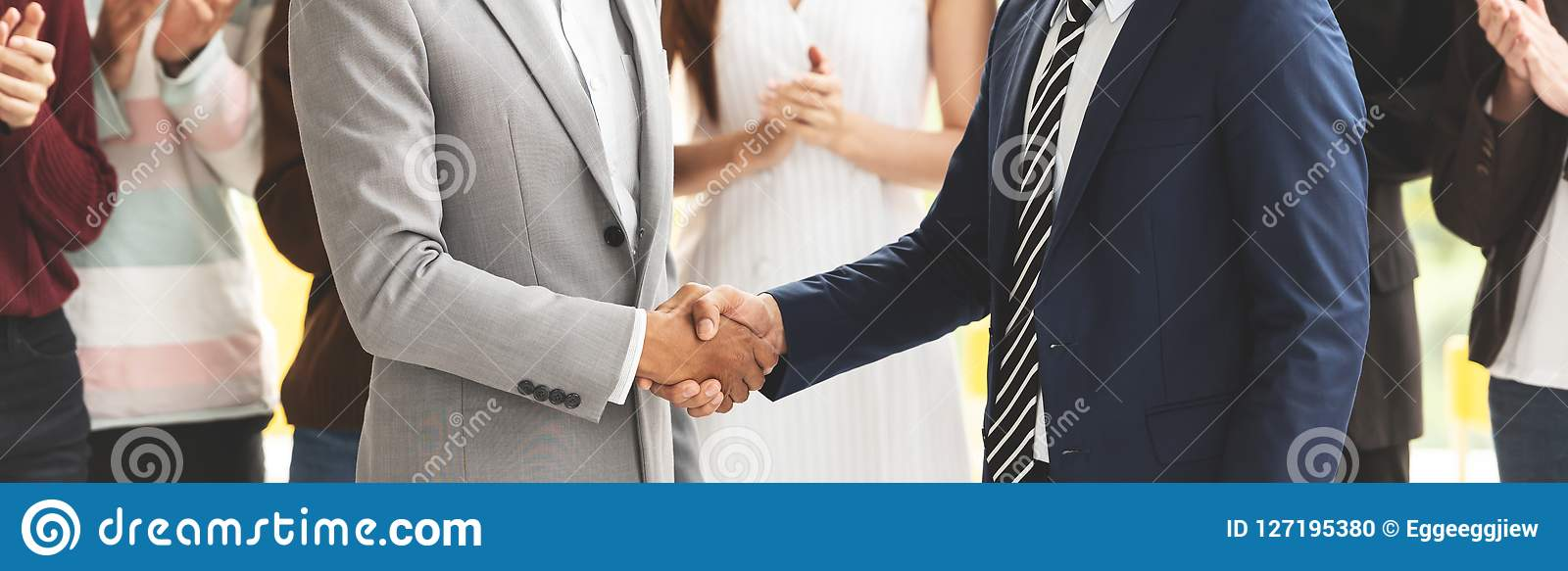 Cropped Image of Successful Businessmen shaking hands together.