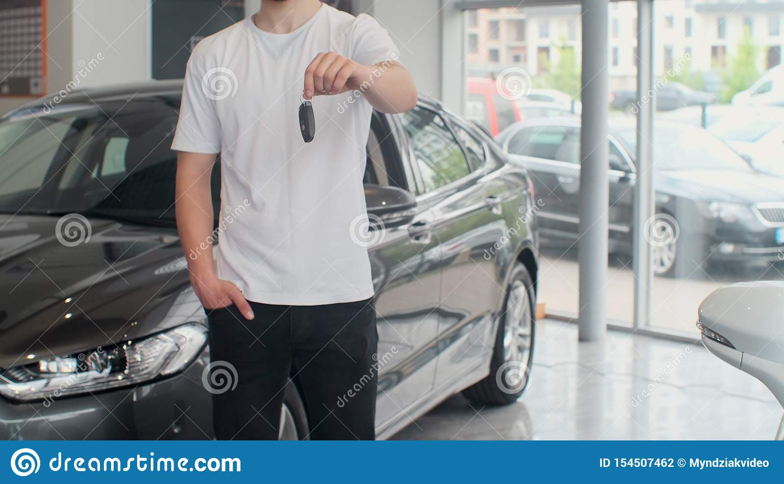 Cropped Shot Of A Midsection Of A Male Customer Holding Out Car Keys To His Newly Bought Car Man Holding Car Keys Stock Photo Image Of Sale Buyer 154507462