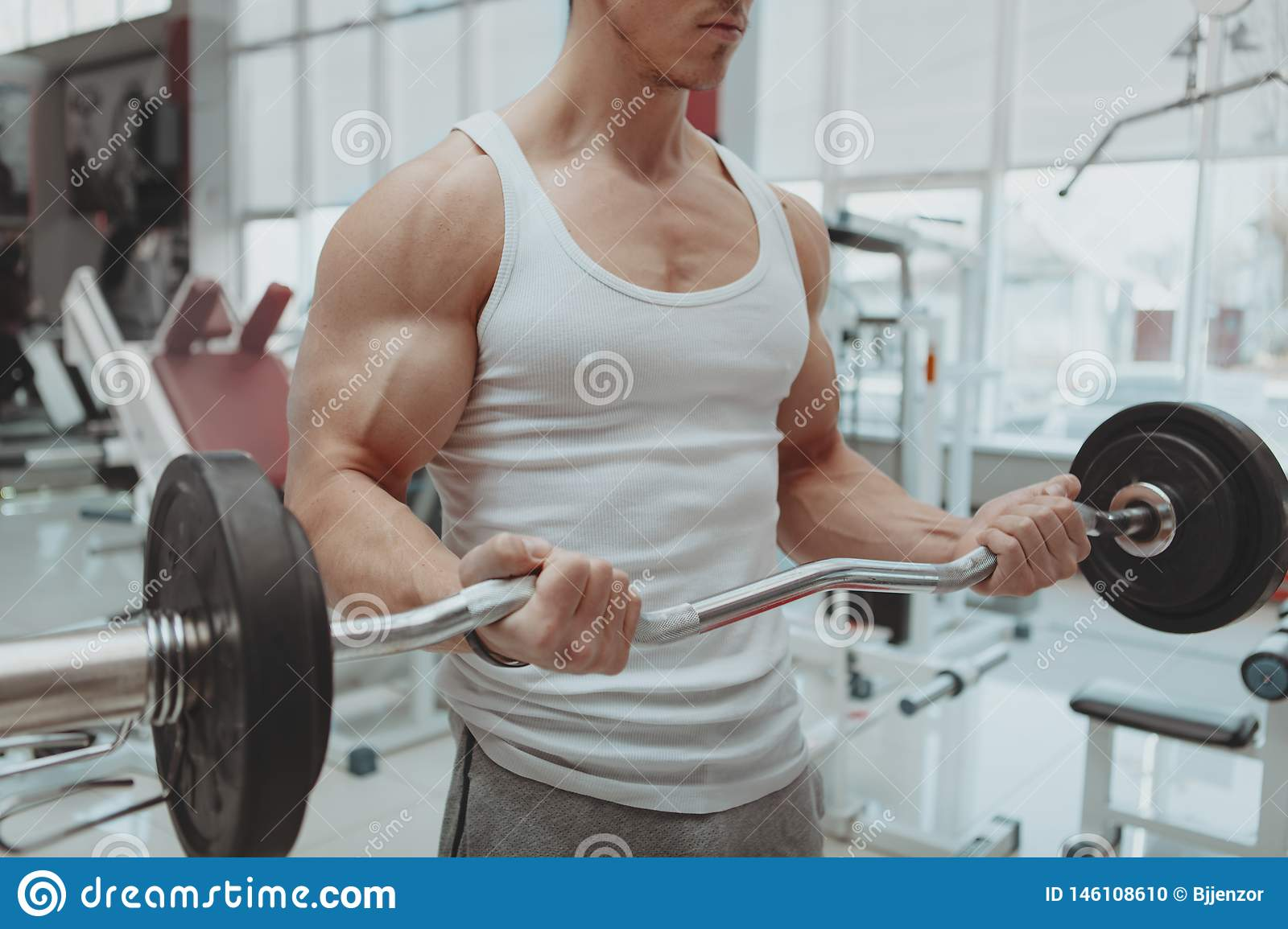 Muscular man working out at the gym
