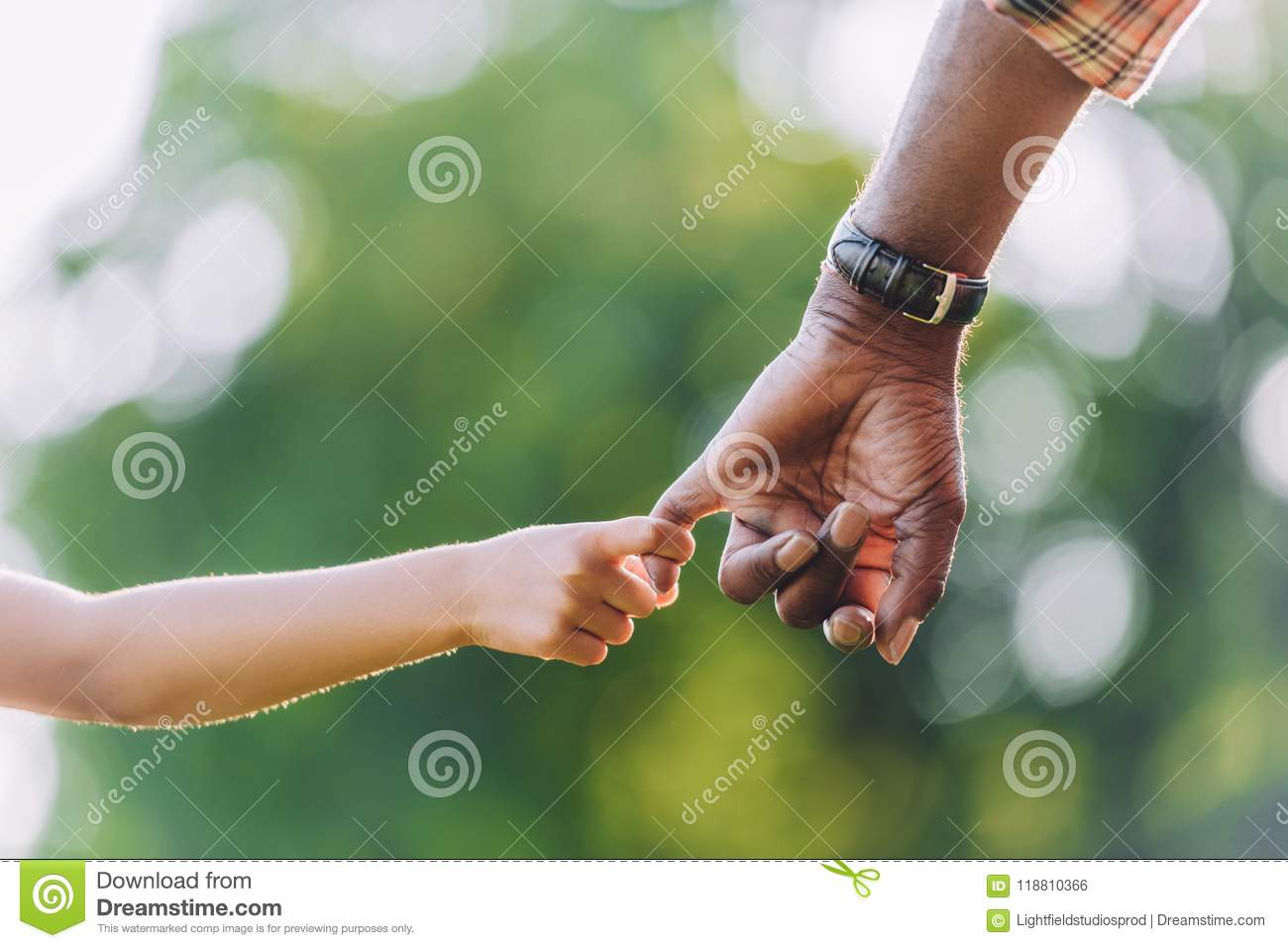 cropped view of african american grandfather holding hands