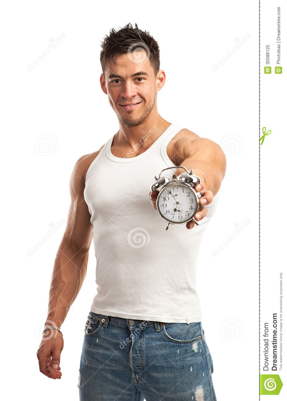 Cropped view of a muscular young man holding clock