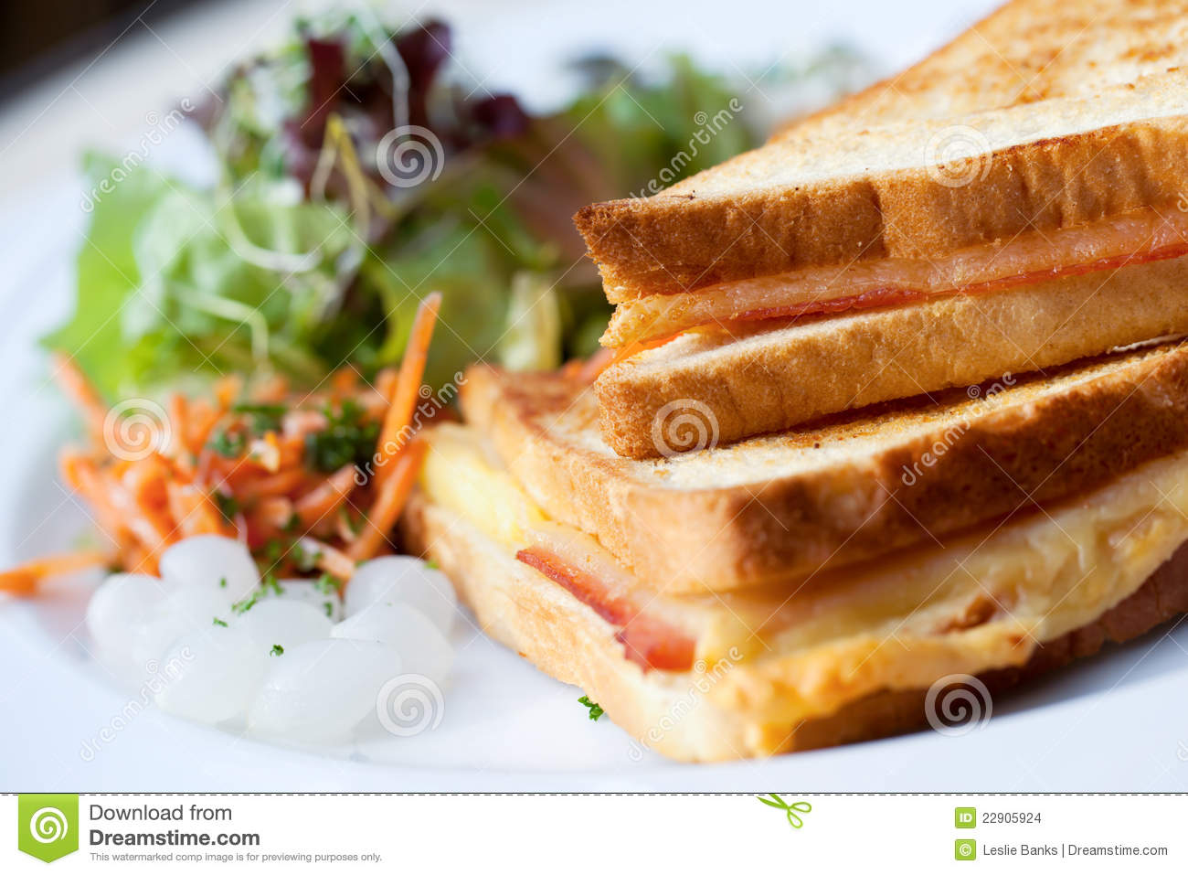 croque monsieur sandwich, or hot ham and cheese, with salad and ...
