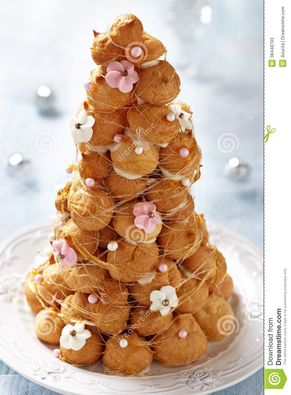 croquembouche with pink and white frosting roses stock