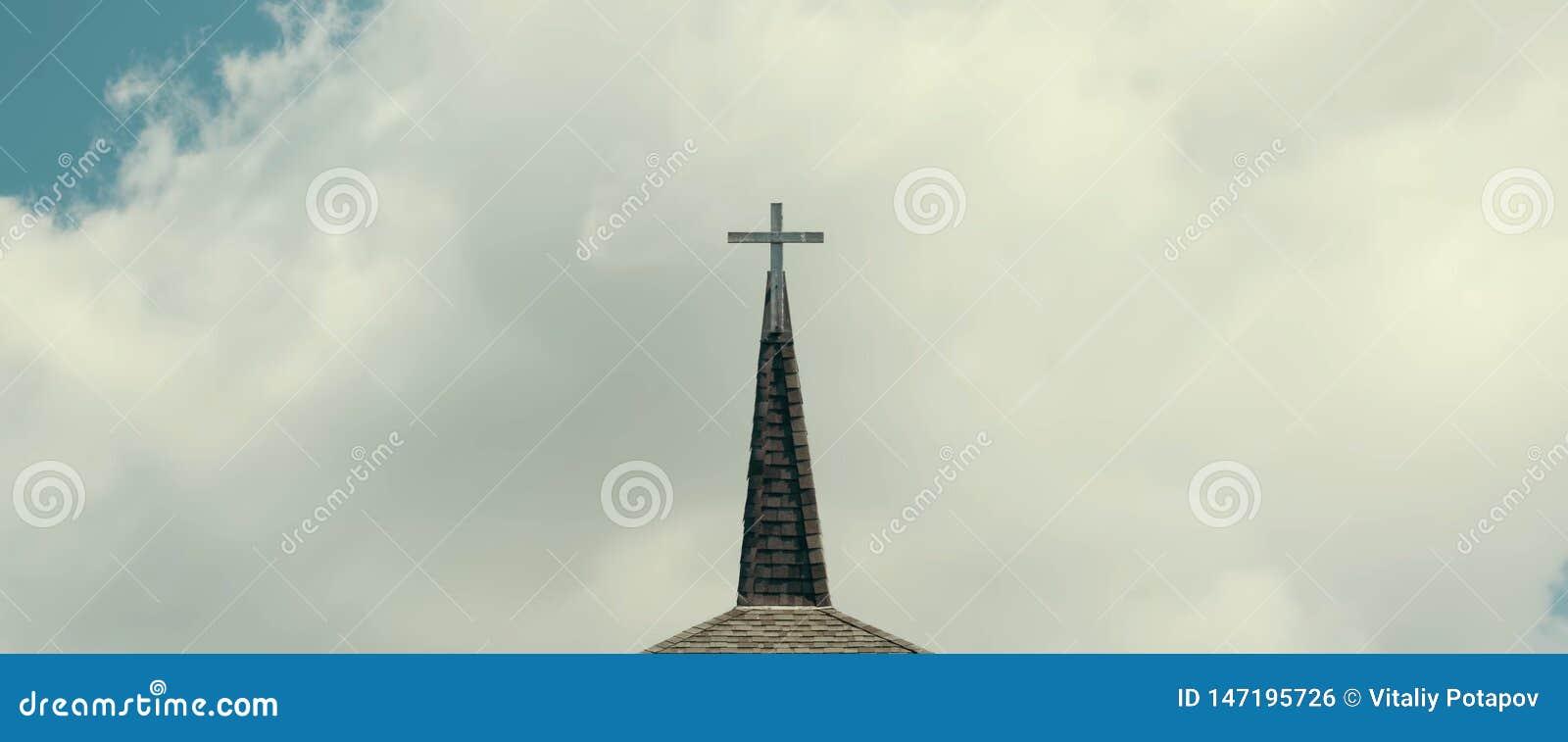 Cross Against Cloudy Sky.