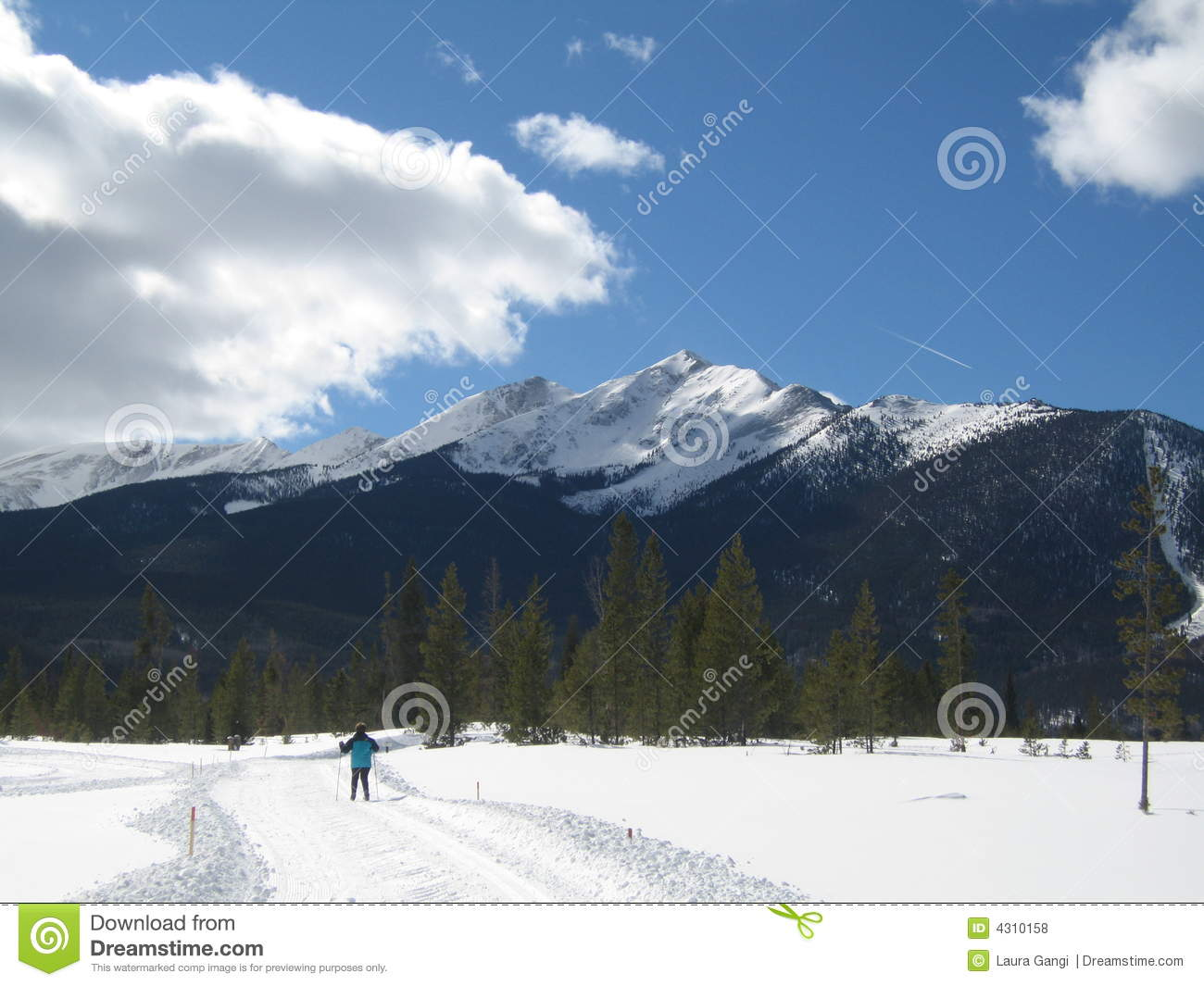 Cross Country Skier with Snowy Peak