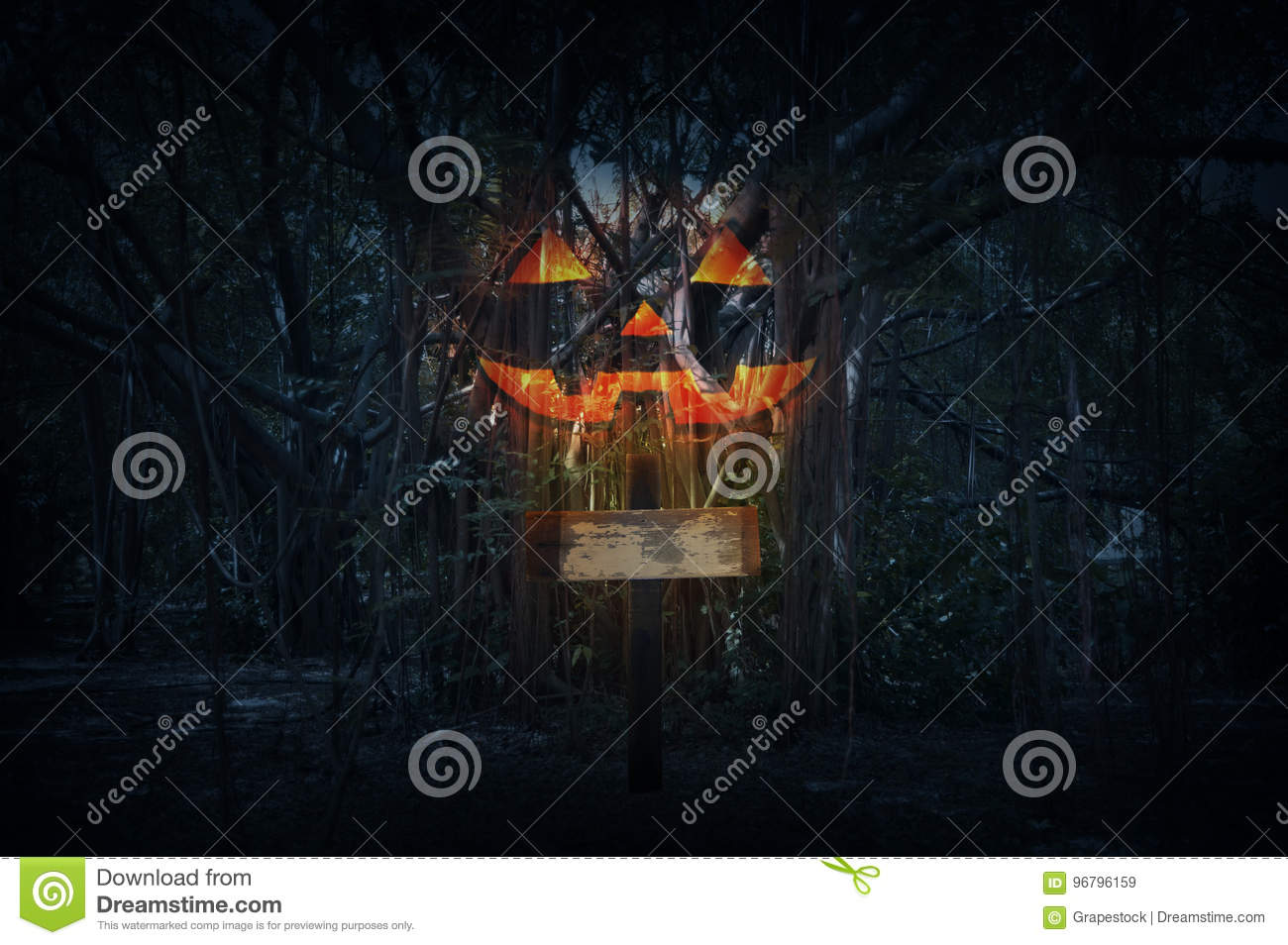 Cross with Jack O Lantern pumpkin over spooky forest at night ti